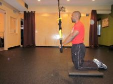 trx kneeling plank roll out