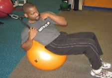 stability ball oblique crunches with a cable