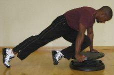 plank twist with knee raises