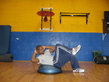 bicycle crunches on a bosu ball