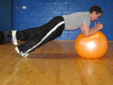 plank on a stability ball with 1 leg