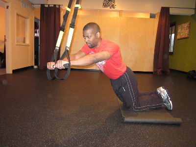 trx kneeling plank roll out for obliques to the left