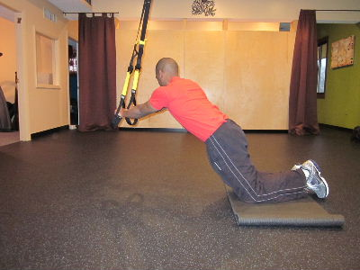 trx kneeling plank roll out for obliues to the right