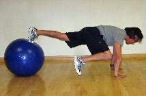 ball plank with frog kicks