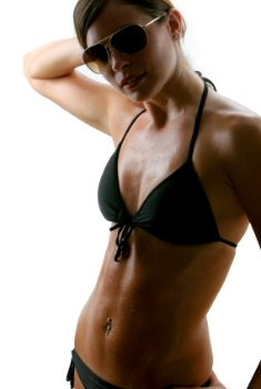 picture of lady in bikini with a flat stomach